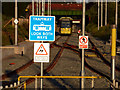 SJ8293 : Signs at the south east end of St Werburgh's Road Metrolink station, Chorlton by Phil Champion