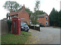 SK6936 : Cottages and telephone box by Alan Murray-Rust
