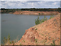 SP2382 : Flooded sand and gravel quarry  by Robin Stott