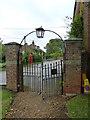 SP9832 : Church End- St. John the Baptist, Eversholt: church gates by Basher Eyre