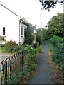 TM2972 : Footpath past All Saints' churchyard, Laxfield by Evelyn Simak