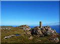 NG5739 : Dun Caan trigpoint by John Allan