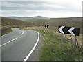 SJ9968 : Double bend, A54 west of Cut-thorn Hill  by Robin Stott