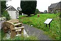 NY5052 : Benches and information board, Cumwhitton churchyard by Rose and Trev Clough