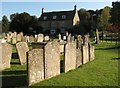 SK9211 : Exton churchyard and Yew Tree House by John Sutton