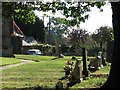 SK8616 : Teigh churchyard in September by John Sutton