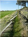 SE0126 : Fence leaning over public footpath, Mytholmroyd by Humphrey Bolton