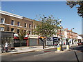 TQ3272 : Row of Shops, Rosendale Road by David Anstiss