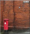 SJ9593 : Postbox on School Lane by Gerald England