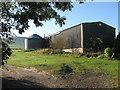 TQ4507 : Barn and Silo, Well House by Simon Carey