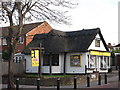 TQ3565 : Thatched Estate Agents Office, Shirley by David Anstiss
