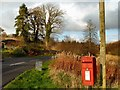 NX3576 : Post Box at House o' Hill by Andy Farrington