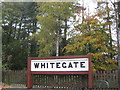 SJ6167 : Former station sign preserved beside Whitegate Way by Dr Duncan Pepper