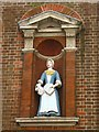 TQ3480 : The (former) Raine Street charity school, E1 - Bluecoat girl statue by Mike Quinn