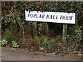 TM1771 : Poplar Hall Farm sign by Adrian Cable