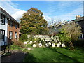 TQ4110 : Gravestones at the Friends Meeting House by Basher Eyre