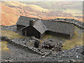NY2315 : Climbing hut among Rigg Head Quarries by Trevor Littlewood