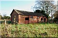 SJ7930 : Derelict Red Brick Stables at Sugnall by Mick Malpass