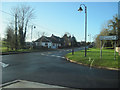 SP6532 : Road junction in Tingewick by John Firth