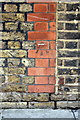 TQ3182 : Benchmark on SS Peter & Paul school, Compton Street by Roger Templeman