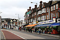 A parade of shops adjacent to the junction with Ealing Road.  The shops offer bulk vegetables to their customers - presumably a number of which run restaurants in the area.