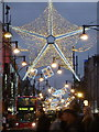 TQ2881 : London: big star over Oxford Street by Chris Downer