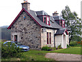 NN5890 : Cottage on north side of A86 by Trevor Littlewood