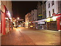 TQ7567 : Chatham, High Street (at night) by David Anstiss