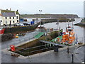 NT9464 : Eyemouth: river mouth and lifeboat by Chris Downer