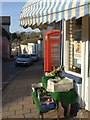 SS6601 : Shop and phone box, North Tawton by Derek Harper