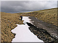 NN4286 : Snow banks in stream groove draining into Moy Corrie by Trevor Littlewood