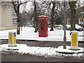 TQ3977 : Phone box and bollards by Stephen Craven