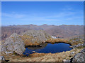 NM8279 : Lochan on north ridge of Beinn Mhic Cèdidh by Trevor Littlewood