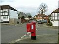 TQ4574 : Corner pillar box by Robin Webster