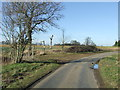 TL8538 : Country Road And Footpath by Keith Evans
