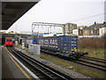 TQ2182 : Willesden Junction: freight train passing and tube approaching by Christopher Hilton