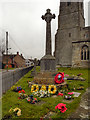 SO7403 : Slimbridge War Memorial and Church by David Dixon