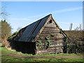 TL4055 : Barton: weatherboarded barn by John Sutton