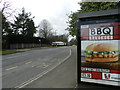 SK3234 : Fast food advert on bus stop near school by Peter Barr