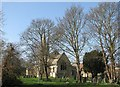 TL4765 : Landbeach churchyard in early spring by John Sutton