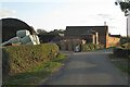 SP4476 : Bales and barns, Burnham's Farm by Robin Stott