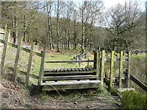 SD9922 : A wide stile near Round Hill Wood, Cragg Vale by Humphrey Bolton