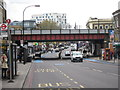 TQ2975 : Railway bridge over Clapham High Street by Oast House Archive