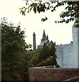 NO5960 : Brechin Cathedral and Round Tower glimpsed from the High Street by Elliott Simpson