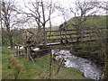 NY5180 : Footbridge over Bailey Water by Les Hull
