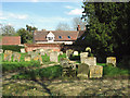 TL7452 : Cottages adjoining St Margaret's churchyard, Stradishall by Evelyn Simak