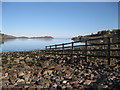 NG8154 : Fence on Shieldaig shore by Bob Jones