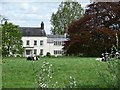 SJ7271 : Dairy cows grazing in front of Allostock Hall by Christine Johnstone