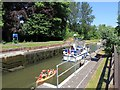 SU9777 : Boats leaving Romney Lock by David P Howard