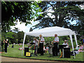 SP9912 : The Jolly Jazzers in the Fernery Garden on Fete Day, Ashridge House by Chris Reynolds